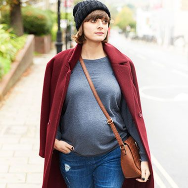 """Invest in two to three pairs of good maternity jeans, including a skinny cut and a boyfriend style – they go with everything"""